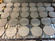 The coasters drying before going in the kiln